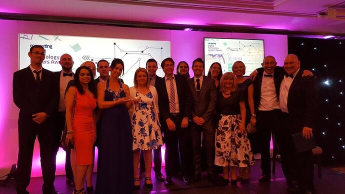 New Charter Group's Business Transformation team receiving the Digital Team of the Year award.jpg